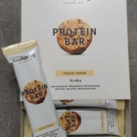 Une boite de 12 Protein Bar cookie dough de Foodspring